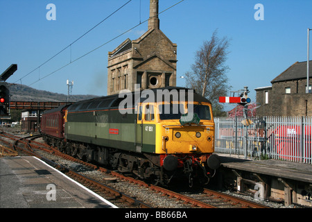 Brush type 4 diesel locomotive 47 851 in two tone green livery with empty stock at Carnforth station. - Stock Photo