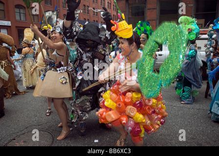 Recyclers battle trash in a piece of street theater during the Earth Celebrations Hudson River Pageant in New York - Stock Photo