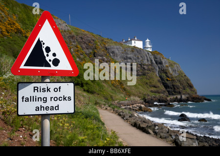 risk of falling rocks sign at blackhead lighthouse and the whitehead to blackhead coastal path county antrim northern - Stock Photo