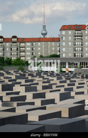 Berlin Germany Memorial to the Murdered Jews of Europe aka Holocaust Memorial Fernsehturm TV tower in background - Stock Photo