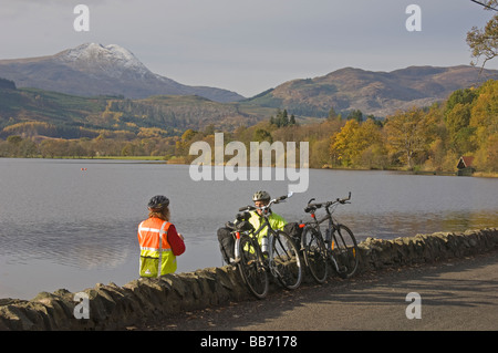 Autumn colours in the Trossachs Loch Ard looking to Ben Lomond Cyclists Perthshire Scotland November 2008 - Stock Photo
