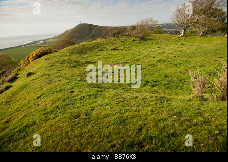 The site of the original Motte and Bailey Aberystwyth Castle with the iron age hillfort of Pen Dinas in the background - Stock Photo