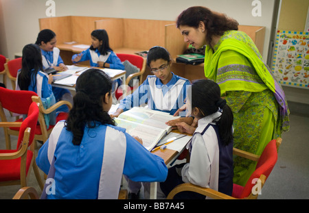 Students at class at National Book Foundation in Islamabad - Stock Photo