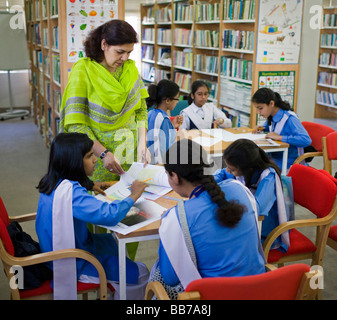 Student at class at National Book Foundation in Islamabad - Stock Photo