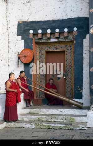 Monks play horns, Trongsa Dzong, BHUTAN - Stock Photo