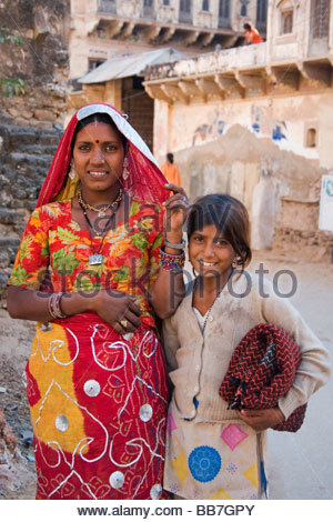 Indian woman with child wearing traditional dress, North India, India, Asia - Stock Photo