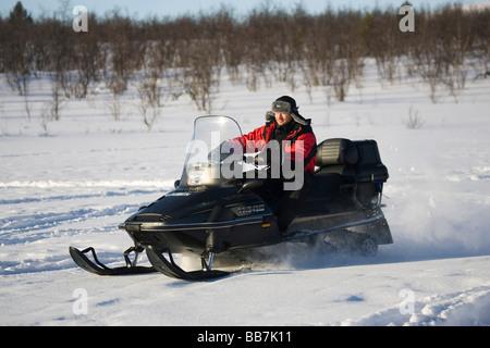 A snowmobile rider in Kiruna, North Sweden, Sweden - Stock Photo