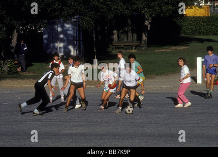 French Basque students, students playing soccer, boys, girls, soccer players, playing soccer, gym class, French - Stock Photo