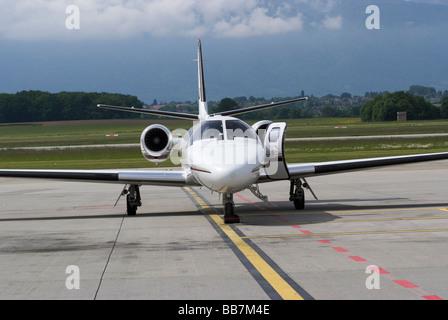 NetJets Cessna 550b Citation Bravo CS-DHJ Business Jet Parked on Apron at Geneva Airport Switzerland Geneve Suisse - Stock Photo