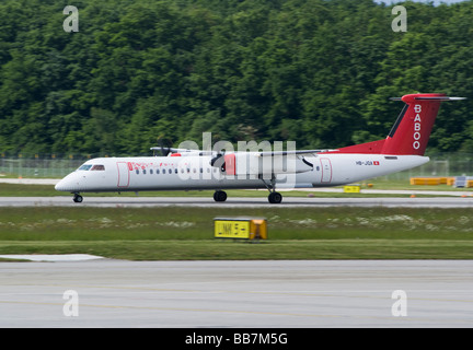 Baboo Bombardier DHC-8-402 Q400 HB-JQA Airliner taking Off From Geneva Airport Switzerland Geneve Suisse - Stock Photo