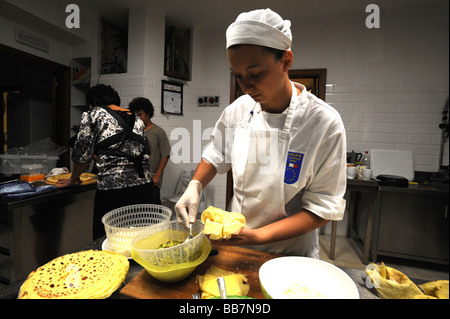 Pasta and Italian food being prepared in kitchen in hotel - Stock Photo