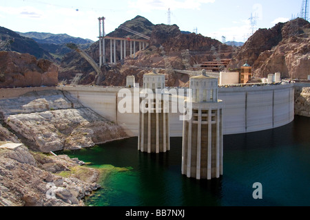 Intake towers of the Hoover Dam on the border between the states of Arizona and Nevada USA - Stock Photo