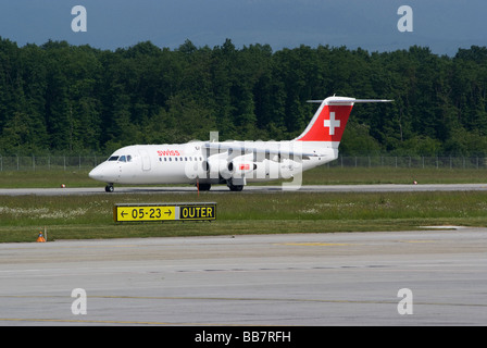 Swiss European Air Lines Avro RJ100 (BAe Avro146-RJ100) HB-IXU Landing at Geneva Airport Switzerland Geneve Suisse - Stock Photo