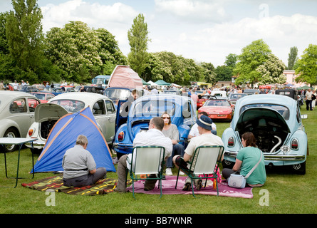 Volkswagen beetle enthusiasts with their cars  at a classic car rally, Wallingford, Oxfordshire, UK - Stock Photo