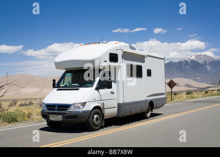 RV driving to Great Sand Dunes National Park in Colorado - Stock Photo