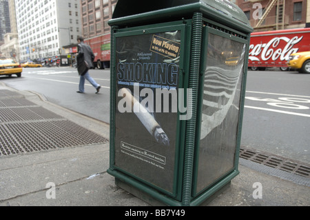 An ad on a trash can on the streets of midtown in New York on April 20 2009 calls for restricting smoking to R rated - Stock Photo