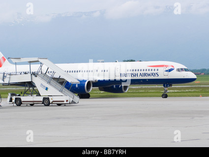 British Airways Boeing 757-236 (ET) G-BPEE Airliner Taxiing Past Mobile Stairway at Geneva Airport Switzerland Geneve - Stock Photo