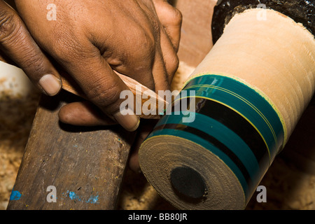 Basic scraping tool carving decorations in a roundwood, Maledives - Stock Photo