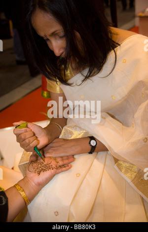 Indian Henna-Tatoo on the palm - Stock Photo