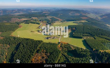 Aerial photo, high altitude village, elevated plain, autumnal forest, Roehrenspring, Sundern, Hochsauerlandkreis, - Stock Photo