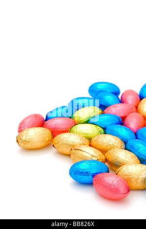 Colourful chocolate eggs wrapped in aluminium foil - Stock Photo