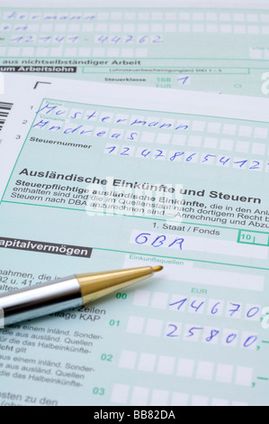 Tax declaration, income and tax from foreign countries, AUS - Stock Photo