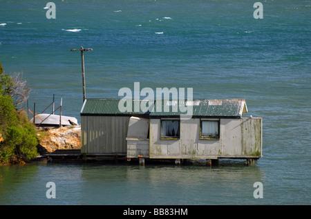 Boat shed near Broad Bay at the Otago Peninsula, New Zealand - Stock Photo