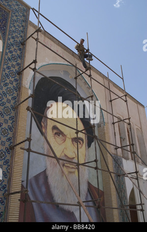 I tile work fresco of the Ayatollah Khomeini being attached to a mosque, Isfahan, Islamic Republic of Iran - Stock Photo