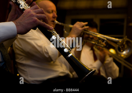 Jazz concert with a clarinette in front of a blurred trumpeter - Stock Photo