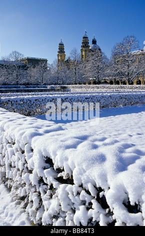 Wintery mood in Hofgarten park and Theatinerkirche Church, Munich, Bavaria, Germany, Europe - Stock Photo