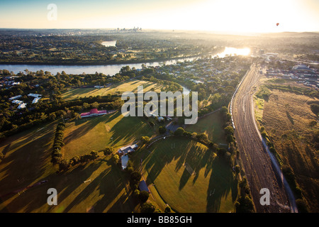 Sunshine over early morning in Brisbane seen from balloon - Stock Photo