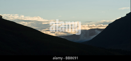 Panoramic view of clouds in a low lying valley in the Injisuthi National Park, Drakensberg, Kwazulu Natal Province, - Stock Photo