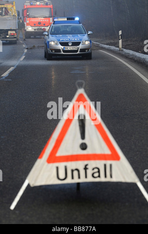 Police car and warning sign, securing the accident scene after a severe traffic accident on L 1150, Esslingen, Baden - Stock Photo