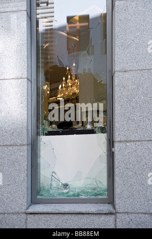 Break-in, broken display window of a jeweller's shop - Stock Photo