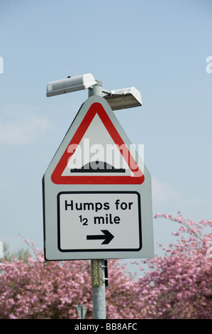 Road sign warning of speed humps for the next half mile in a town in England - Stock Photo