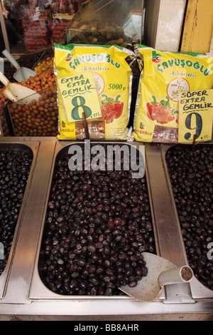 Istanbul Turkey fresh ripe black olives for sale at street market in Eminonu beside the Spice Bazaar area - Stock Photo