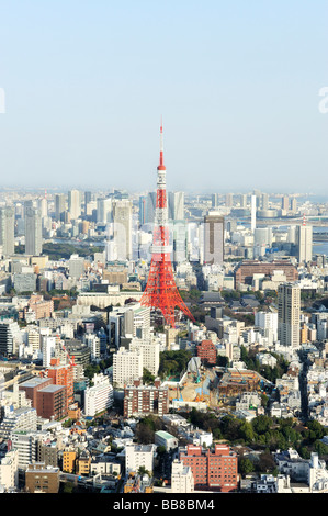 View over Tokyo from the observation deck of Roppongi Hills with Tokyo Tower and Rainbow Bridge, Tokyo, Japan - Stock Photo