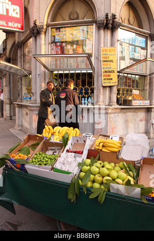 Istanbul Turkey fruit seller and fruit stall at street corner in Gulhane district at evening dusk - Stock Photo