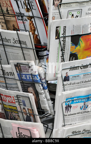News rack with international daily newspapers - Stock Photo