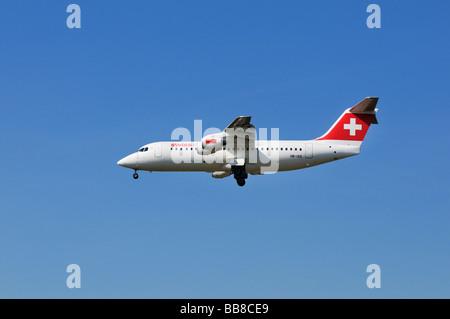 Swiss Air airplane Swiss Avro Regional Jet RJ100 is swinging out its landing gear - Stock Photo