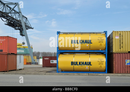 Container terminal Bonn, tank container by Bulkhaul besides Iso containers, next to it gantry crane lifting container on deck o