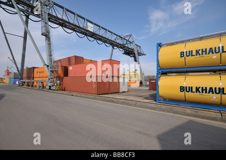 Container terminal Bonn, tank containers and Iso containers, next to it gantry crane lifting container on deck of ship, North R