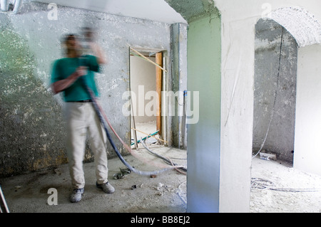 Building site, applying insulation in a cellar - Stock Photo