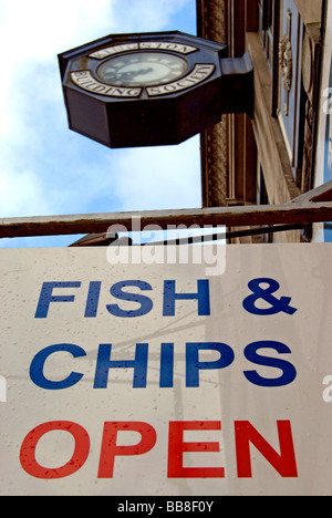 fish & chips open sign outside fish and chip shop in kingston upon thames, surrey, england, beneath clock - Stock Photo