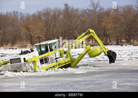 Amphibex Icebreaker machine breaking up ice jams on the Red River, near Selkirk, Manitoba, Canada. - Stock Photo