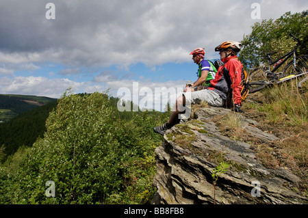 Mountain bike riders resting on Orenberg Mountain, Willingen, Hesse, Germany, Europe - Stock Photo