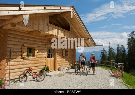 Male and female mountainbike riders on the Wallgauer Alm alpine pasture, Wallgau, Upper Bavaria, Bavaria, Germany, - Stock Photo