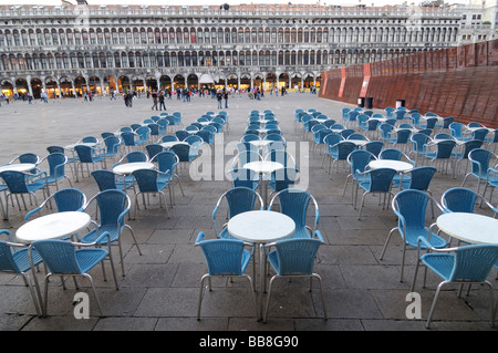 Deserted bistro tables on St. Mark's Square, Venice, Italy, Europe - Stock Photo