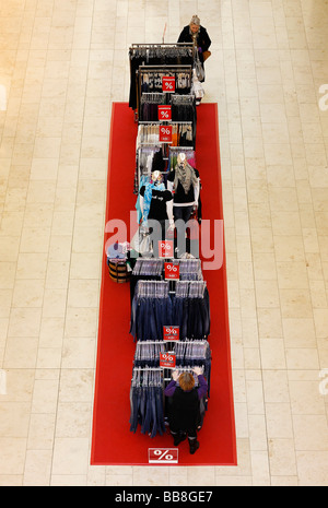 Clothes for sale, clothes hanger on a red carpet, fashion boutique, view from above, Germany, Europe - Stock Photo