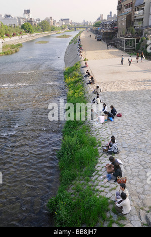 Couples at the Kamo River in the city centre of Kyoto, Japan, Asia - Stock Photo